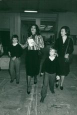 Sophia Loren arrives at a television studio in Paris with her two sons Carlo and Eduardo