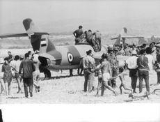 People gathered around the plane in Israel.