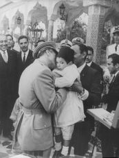 Mohammad Reza Pahlavi kissing a little boy in Iran.  - Jun 1966