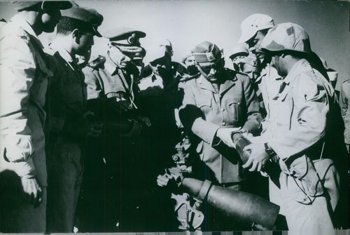 Soldiers checking on cannon shells in Yemen.