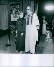 Richard Deacon standing with a woman and smiling.