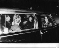 "Robert Francis ""Bobby"" Kennedy's fammily members sitting in car."