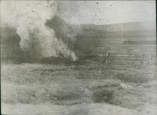 Photo of a bomb exploded in the ground. 1935
