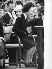 Princess Margaret sitting in crowded place.