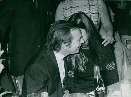 Christiaan Barnard smiling while listening to his wife Barbara.  - 1970