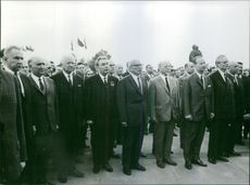 Alexander Dubček forming a line with his colleagues.