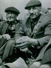 Close up of two people sitting together, facing camera and smiling.  1966 The memory of Verdun