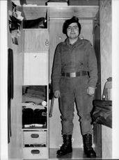 West Germany's smallest soldier, Gerhard Weiss, shows how he easily finds space in his wardrobe