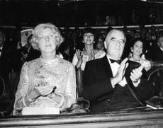 Georges Jean Raymond Pompidou sitting with a woman in spectators.