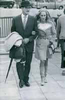 Ursula Andress stars as Lady Britt Dorset and Stanley Baker as Mr. Graham in Perfect Friday. 1969.