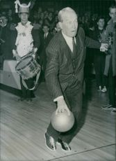 Maurice Chevalier playing bowling.