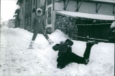 Christine Bare. People playing on snow. Picture taken by photographer Cecil Beaton
