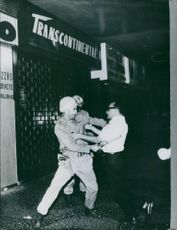 Police confronting man in Brazil August 1961.