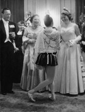 Queen Juliane Louise Emma Marie Wilhelmina talking and appreciating to a dancer in a royal party.