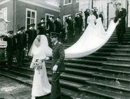 Princess Margriet of the Netherlands and Pieter van Vollenhoven walking out of church.