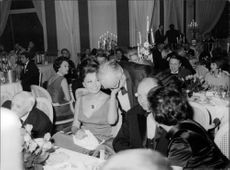 Sophia Loren with her husband C. Ponti at a function.