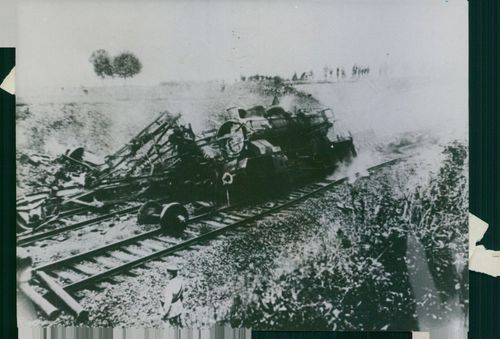 View of a crashed train in the railway track during the Battle of France.