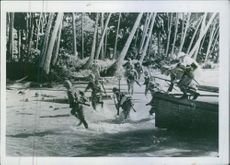 Japanese troopers getting off from the boat and running during the training.