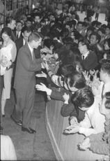 "Robert Francis ""Bobby"" Kennedy greeting his supporters warmly."
