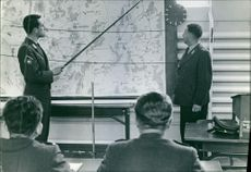 An officer is explaining the target plan to the military staff during German war.