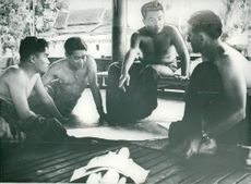 King Norodom Sihanouk points to the map during a war. T.H. The king sees his military adviser, the French captain Hogard