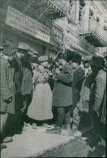 People gathered in street and talking to each other.