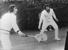Ilie Nastase and Ion Tiriac playing tennis.