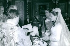 Bride and groom standing during the royal marriage ceremony.