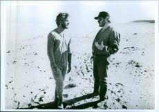 Director Lawrence Kasdan and actor Kevin Kline on the set of the film Silverado.