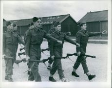 Britain's American Soldiers men marching while holding their rifle, Charles Bolte second from the left during the German wartime with England.