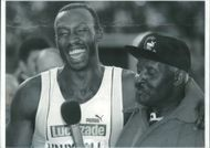 Linford Christie with  another man.