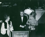 Carol Burnett, Julie Sommars and Henry Gibson smiling.