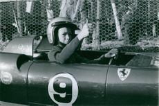 Woman driver during a car race.
