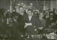 Pierre Laval holds a radio speech at his office.