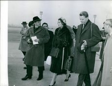 Princess Alexandra having communication with other people walking beside her.1961