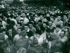 Military officers trying to control the crowd in Algeria.