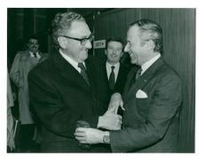 Henry Kissinger is welcomed by Gaston Thorn on arrival in Brussels