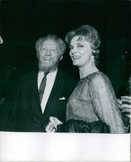 American actor Sam Jaffe is smiling with his wife actress Bettye Ackerman, both of them have looked towards the camera