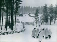 People walking towards the truck during the Winter War, Finland, 1940.