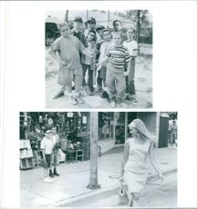 """A photos of the kids and beautiful woman in a film """"The Sandlot"""""""