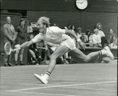 Tennis player Stan Smith in full action during the match against J. Borowiak at Wimbledon Station.