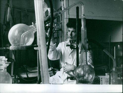 A SCIENTIST DOING AN EXPERIMENT