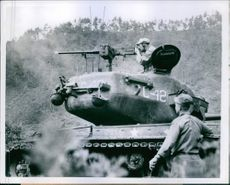 Sgt. Abraham Mandel of Cleveland, Ohio, fires a fifty calibar machine gun into a Korean hut where Red Troops were found to be hiding.