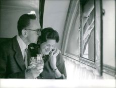 Vintilă Horia is passing a emotional time with his wife affectionately. 1960.
