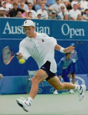 Thomas Johansson is serving the ball during the Australia Open.