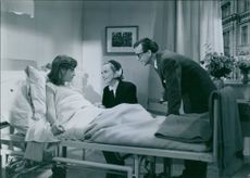 1951 A photo of a Swedish actress Inga Tidblad, a Swedish actor , scriptwriter and music lyricist Elsa Prawitz and  a Swedish film actor and director Alf Kjellin in the movie Divorced.