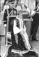 Farah Pahlavi wearing her crown and robe during her son Reza's coronation.  - 1967