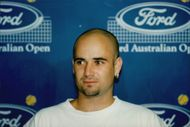 US tennis player Andre Agassi gets fined 1500 dollars after using foul language during the match against Vince Spadea in the Australian Open 1996