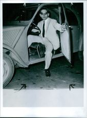 Man getting off from a car.  1966