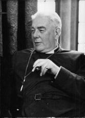 The Rt Rev (Lewis) Mervyn Charles-Edwards in a portrait.